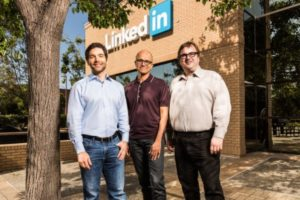 Microsoft CEO Satya Nadella (center) stands with LinkedIn CEO Jeff Weiner (left) and LinkedIn chairman and co-founder Reid Hoffman