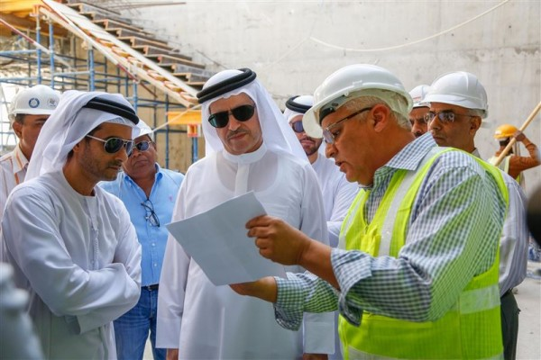 Saeed Mohammed Al Tayer is shown plans at the R&D site within the solar park