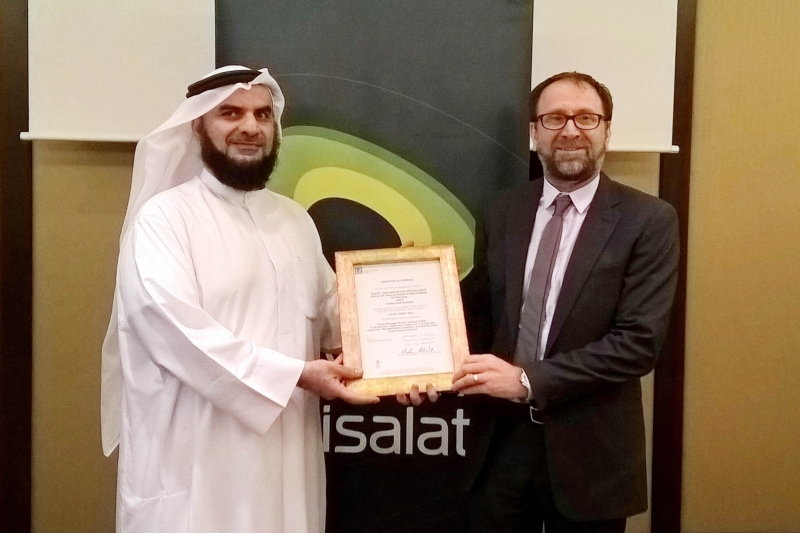 Ahmed Mohamed Darwish, Senior Vice President, Customer Service Engineering receiving the ISO certification from Lloyds