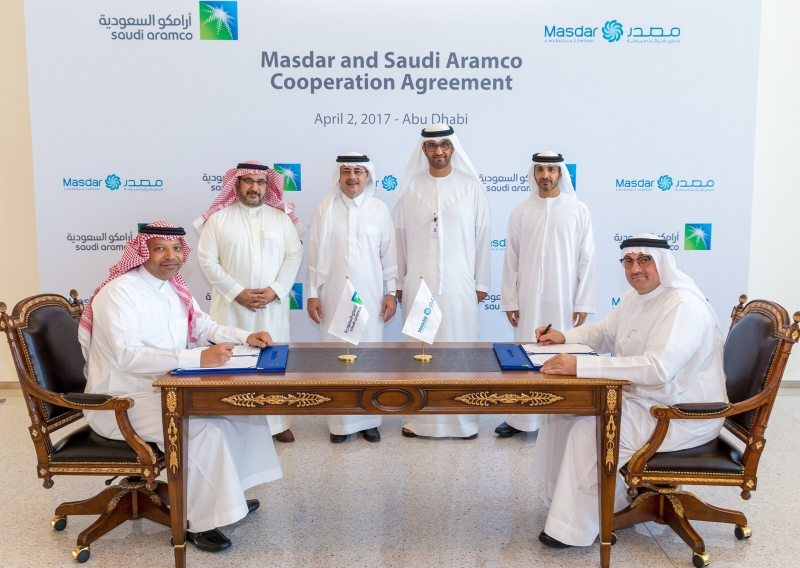 Officials from ADNOC, Masdar and Saudi Aramco during the MoU signing