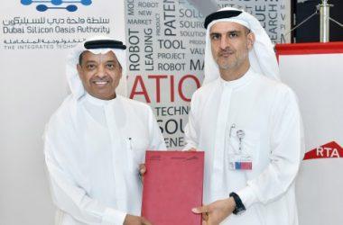 Dr Juma Al Matrooshi and Ahmed Bahrozyan with the MoU