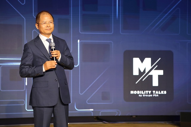 Eric Xu, Huawei's Rotating CEO, during his speech at Groupe PSA's Mobility Talks event, connected cars