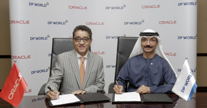 Oracle's business applications SVP for the ECEMEA region Arun Khehar and DP World Group chairman and CEO Sultan Ahmed Bin Sulayem and at the signing of the agreement