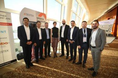 Avaya and Sestek executives celebrate the two companies' enhanced partnership at the Avaya Partner Summit in Dubai.