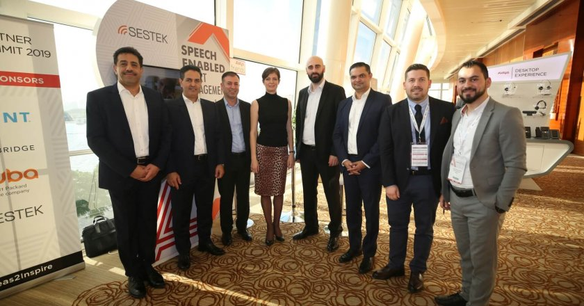 Avaya and Sestek executives celebrate the two companies' enhanced partnership at the Avaya Partner Summit in Dubai.