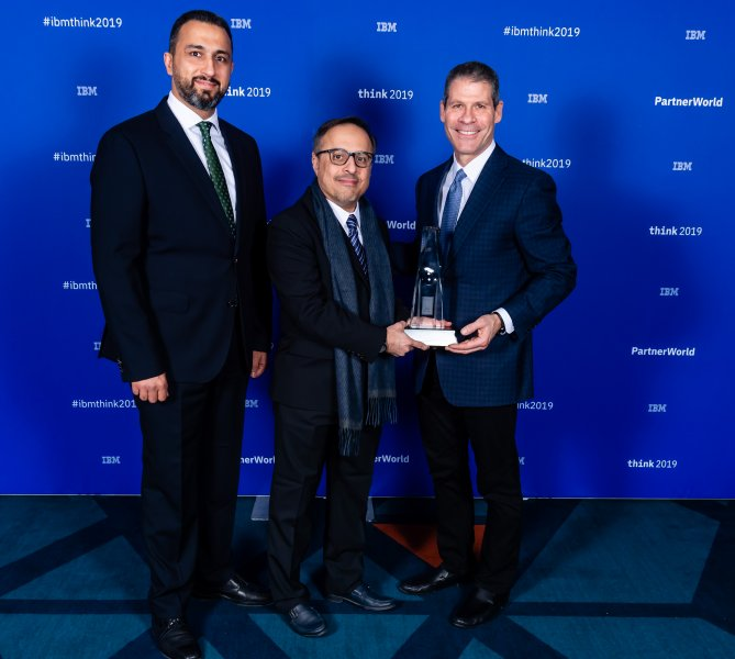 Receiving the award on behalf of SBM is CEO Essam Alshiha (centre) and IBM Systems & Technology Group Sales Manager for SBM, Eyad Al Habbash (left)
